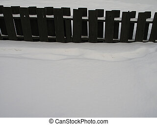 wooden fence with snow