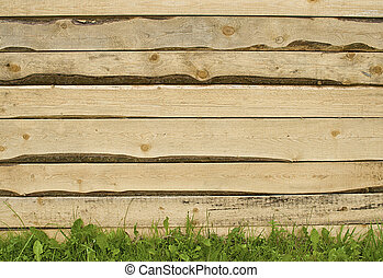 Wooden Fence - Wooden planks fence standing on grass.