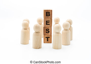 Wooden figures as business team in circle around word BEST