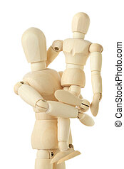 wooden figures of child sitting on hands of his parent, half...