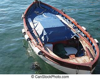 Wooden fishing boat anchored in a village port of Golfo Dei Poeti, Province of La Spezia, Italy