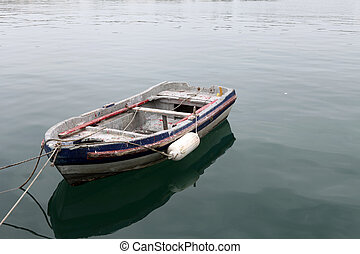 Wooden fishing boat in the port