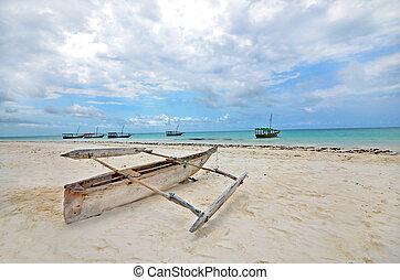 Wooden Fishing boat on a beach of Zanzibar Island