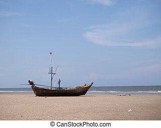 Wooden fishing boat on the Hua Hin beach, Thailand