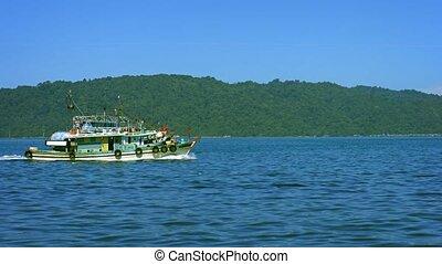 Wooden Fishing Boat Returning to the Harbor in Kota...