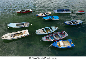 wooden fishing boats anchored in the sea, top view