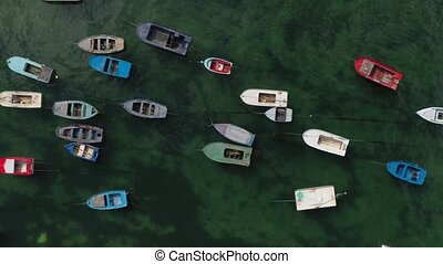 wooden fishing boats anchored in the sea, top view from ...