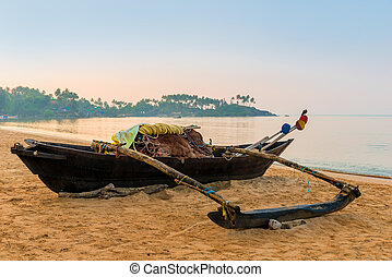 wooden fishing boats at dawn on the beach