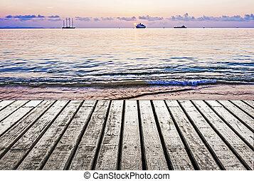Wooden floor and sea sunrise