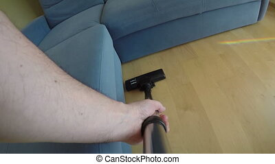 wooden floor hoover - Man hands with vacuum cleaner tool...