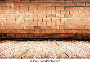 wooden floor with brick wall background