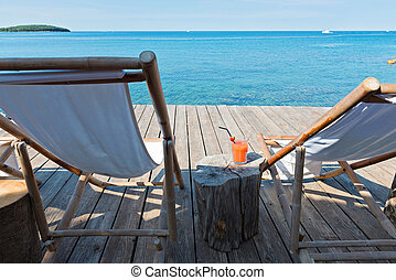 Wooden floor with chaise-longues in Istria