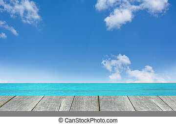 Wooden floor with sea background.