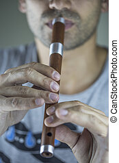 Wooden flute player