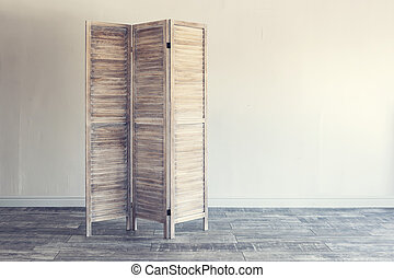 Wooden folding screen on white background.