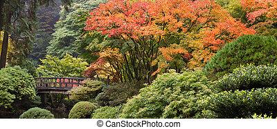 Wooden Foot Bridge at Japanese Garden in Fall