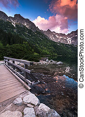 wooden foot bridge in hing mountains over lake