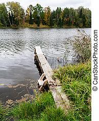 wooden footbridge in the lake