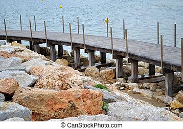 wooden footbridge in the sea