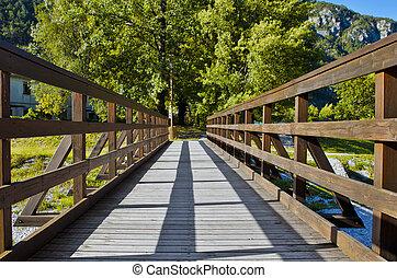 Wooden footbridge - Sunny wooden footbridge