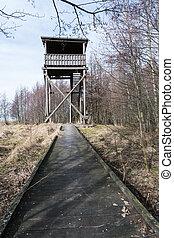Wooden footbridge to the bird watching tower