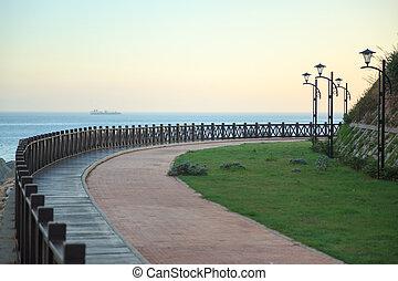 Wooden footpath winding its way along seashore