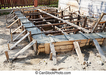 wooden formwork concrete foundation of house at building yard
