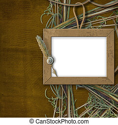 Wooden frame for photo, on the abstract background with grass