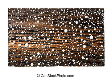 Wooden frame in drops of white paint on a white background.