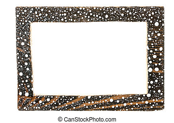 Wooden frame in the drops of white paint. Isolated