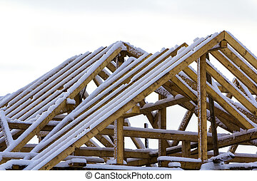 Wooden frame of the roof during construction works on a new house