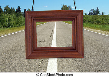 Wooden frame on the background of the road