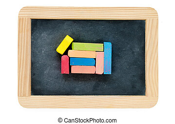 Wooden frame vintage chalkboard isolated on white with colored chalk pieces