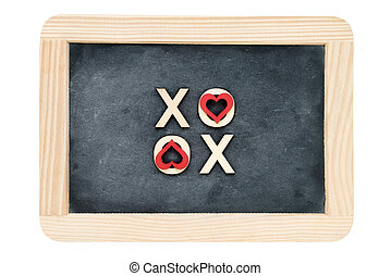 Wooden frame vintage chalkboard isolated on white with text XOXO (kisses & hugs) created of wood letters