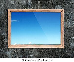 Wooden frame window with view of blue sky