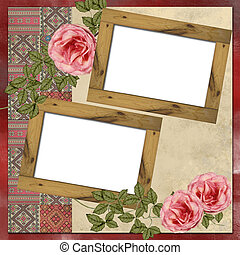 Wooden frames with Ukrainian embroidery and roses on grunge background