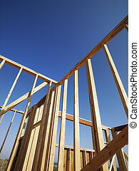 Wooden framework. - Low angle view of new construction...