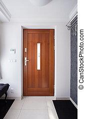 Wooden front door in luxury detached house