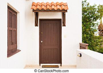 Wooden front door of a home. Front view