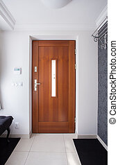 Wooden front door in luxury detached house
