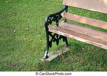 wooden garden chair on green grass