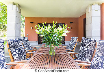 Wooden garden furnitures with flowers