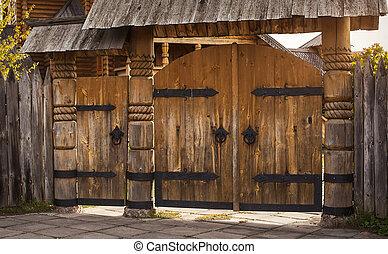 wooden gate, cutting wood.