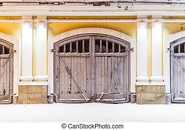 wooden gate of fire station at night in Kostroma