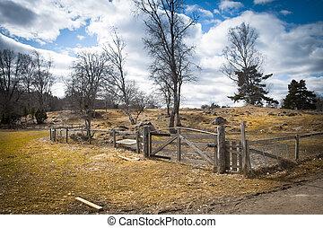 Wooden gate on a field