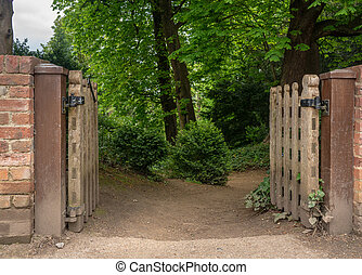 Wooden gateway into mysterious forest path