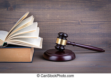 Wooden gavel and books in background. Law and justice concept