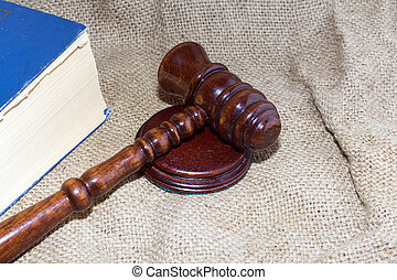 wooden gavel and books on the old bag