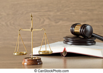 wooden gavel and books - Wooden gavel, golden scales of...