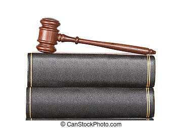 Wooden gavel and law books isolated on white background....